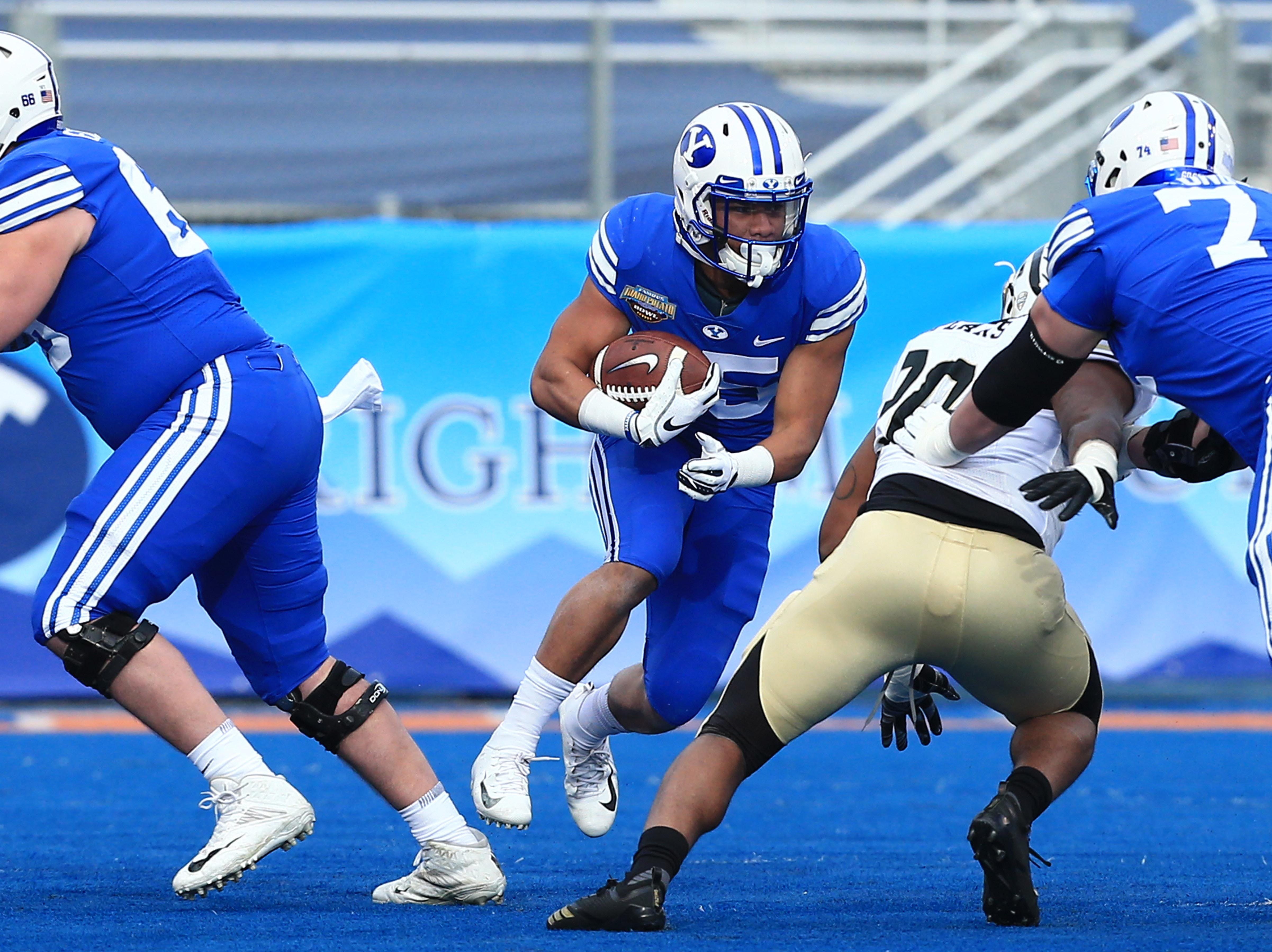 Dec 21, 2018; Boise, ID, United States; Brigham Young Cougars running back Brayden El-Bakri (35) runs during the first half  of play versus the Western Michigan Broncos at the 2018 Potato Bowl at Albertsons Stadium.