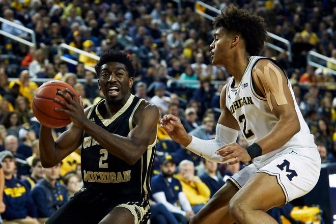 Dec 15, 2018; Ann Arbor, MI, USA; Western Michigan Broncos guard Adrian Martin (2) dribbles defended by Michigan Wolverines guard Jordan Poole (2) in the second half at Crisler Center. Mandatory Credit: Rick Osentoski-USA TODAY Sports