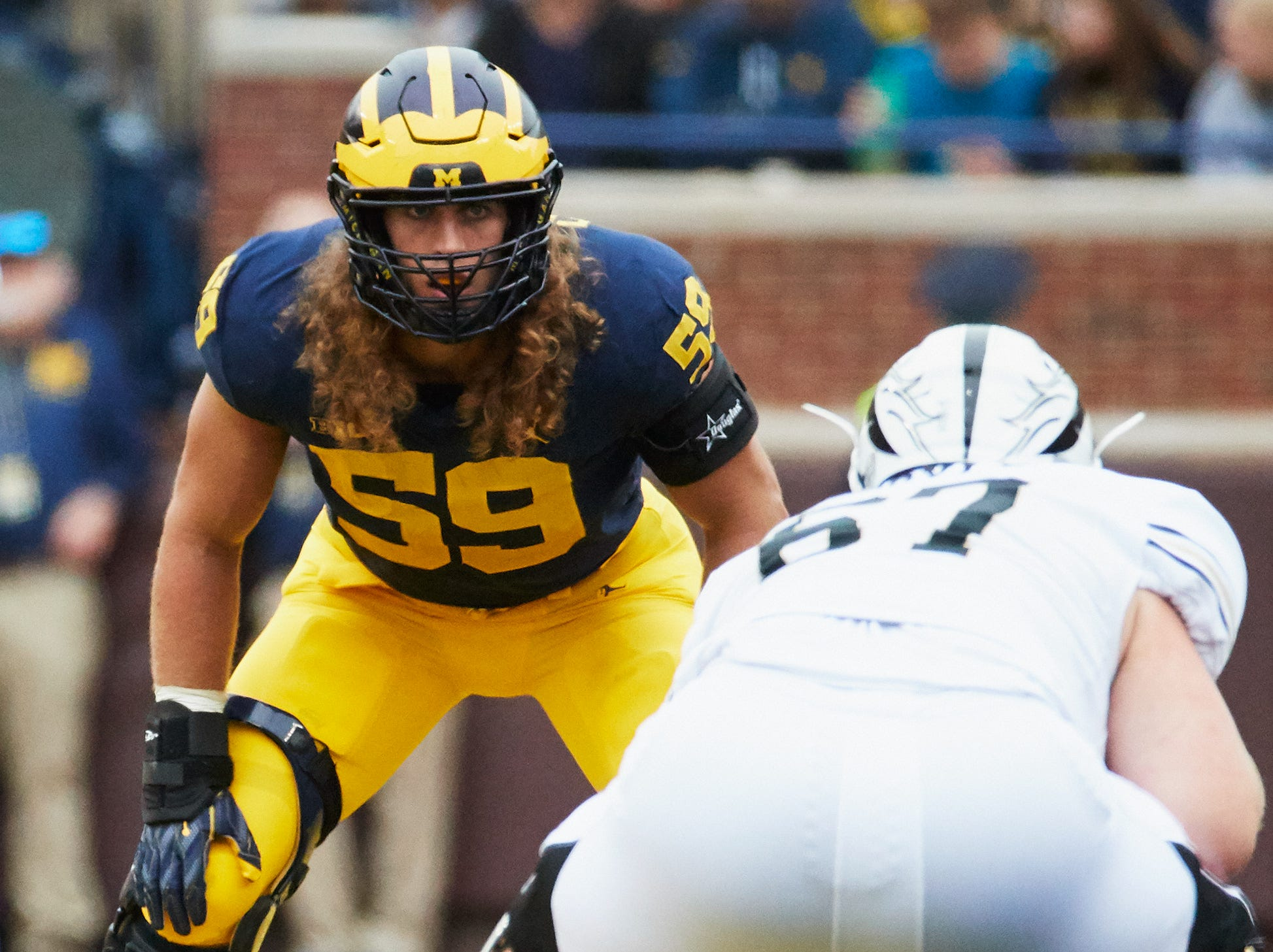 Sep 8, 2018; Ann Arbor, MI, USA; Michigan Wolverines linebacker Noah Furbush (59) gets set against the Western Michigan Broncos at Michigan Stadium. Mandatory Credit: Rick Osentoski-USA TODAY Sports