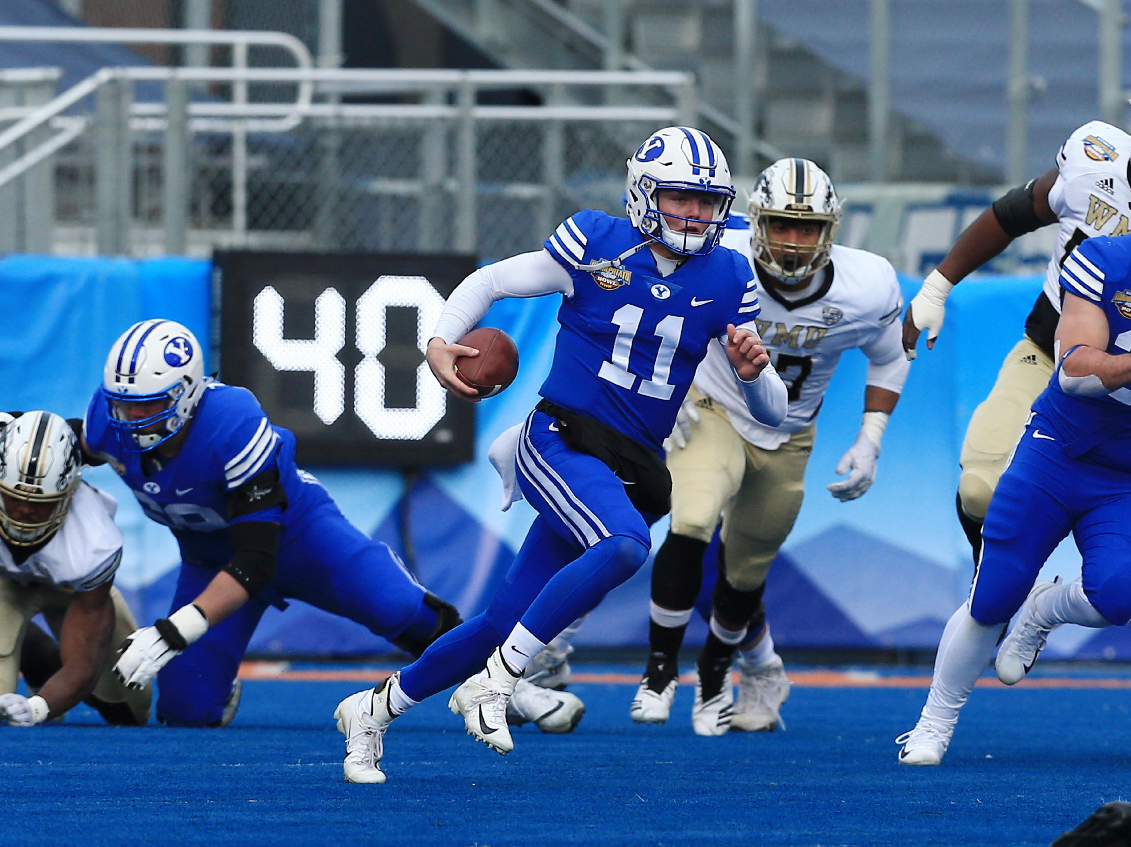 Dec 21, 2018; Boise, ID, United States; Brigham Young Cougars quarterback Zach Wilson (11) scrambles during the first half  of play against the Western Michigan Broncos at the 2018 Potato Bowl at Albertsons Stadium. Mandatory Credit: Brian Losness-USA TODAY Sports