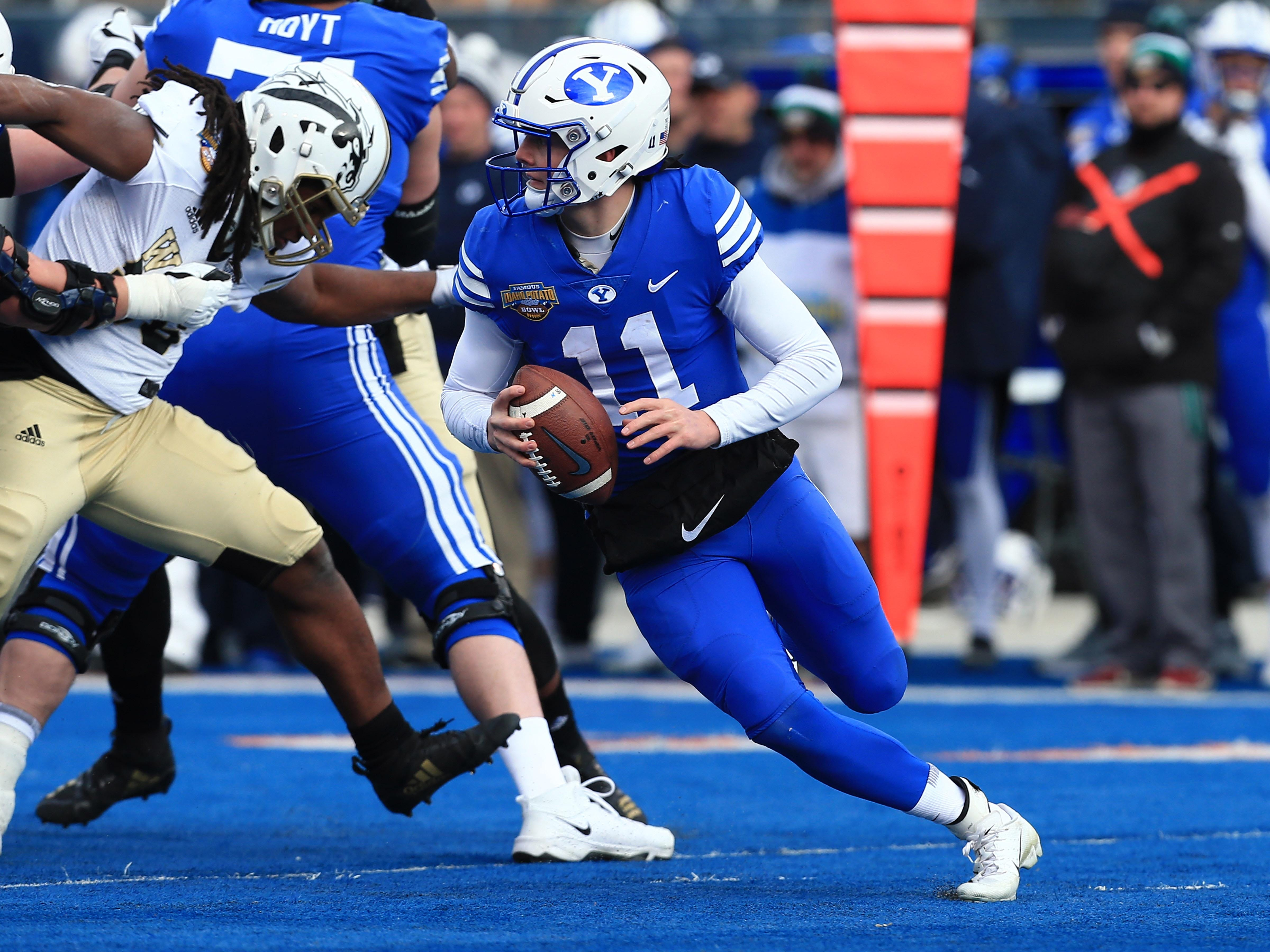 Dec 21, 2018; Boise, ID, United States; Brigham Young Cougars quarterback Zach Wilson (11) runs with the ball in the first half against the Western Michigan Broncos at the 2018 Potato Bowl at Albertsons Stadium.