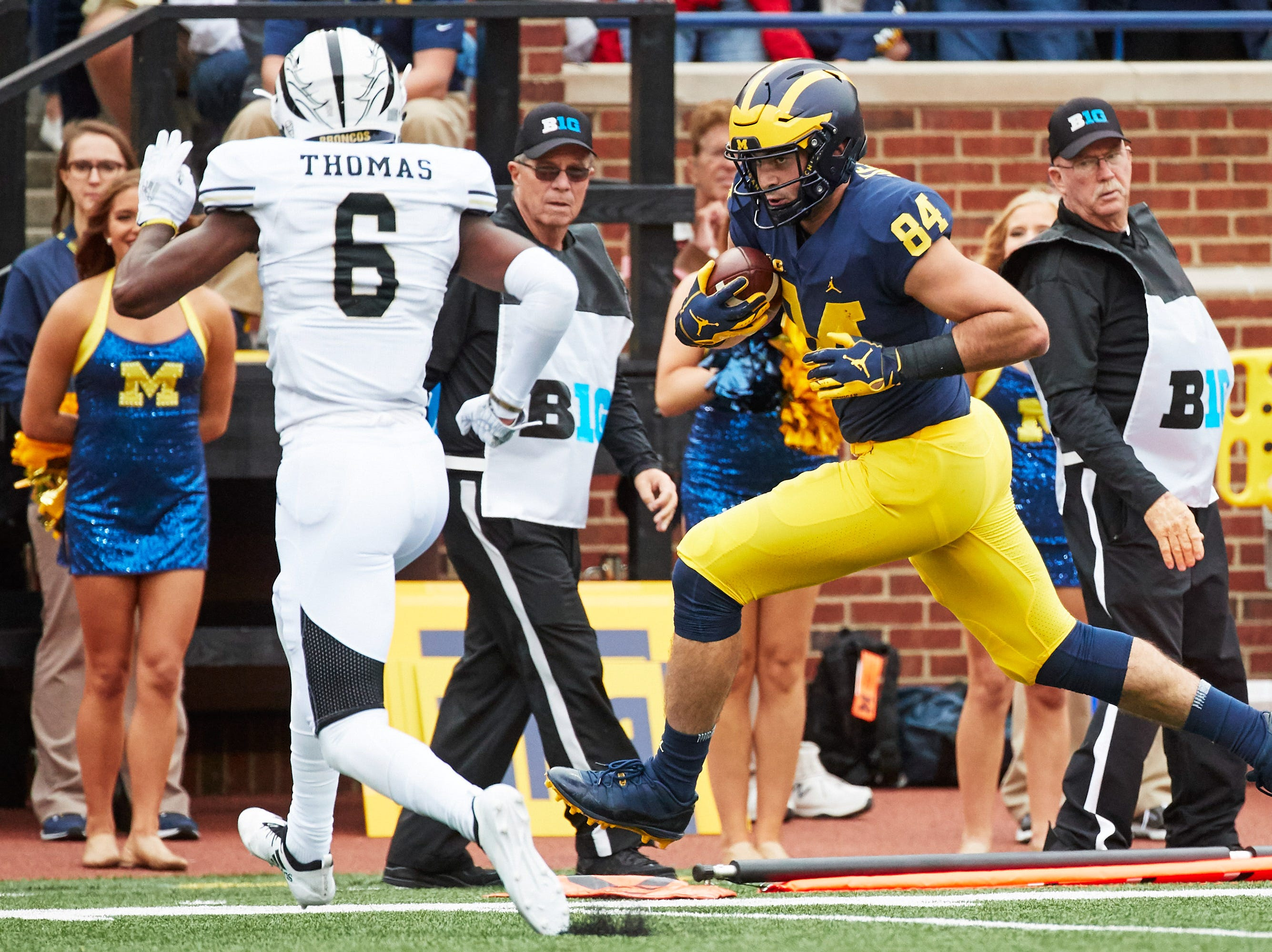 Sep 8, 2018; Ann Arbor, MI, USA; Michigan Wolverines tight end Sean McKeon (84) runs the ball for a touchdown past Western Michigan Broncos wide receiver Drake Harris (6) in the first half at Michigan Stadium. Mandatory Credit: Rick Osentoski-USA TODAY Sports