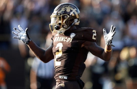 Aug 31, 2018; Kalamazoo, MI, USA; Western Michigan Broncos running back LeVante Bellamy (2) reacts after running for a touchdown during the first quarter against the Syracuse Orange at Waldo Stadium. Mandatory Credit: Raj Mehta-USA TODAY Sports