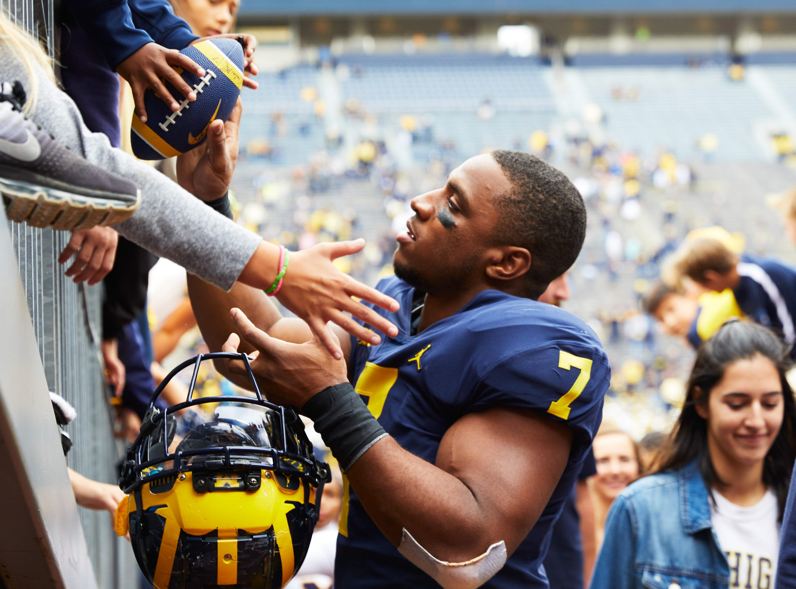 Sep 8, 2018; Ann Arbor, MI, USA; Michigan Wolverines linebacker Khaleke Hudson (7) signs an autograph after the game against the Western Michigan Broncos at Michigan Stadium. Mandatory Credit: Rick Osentoski-USA TODAY Sports