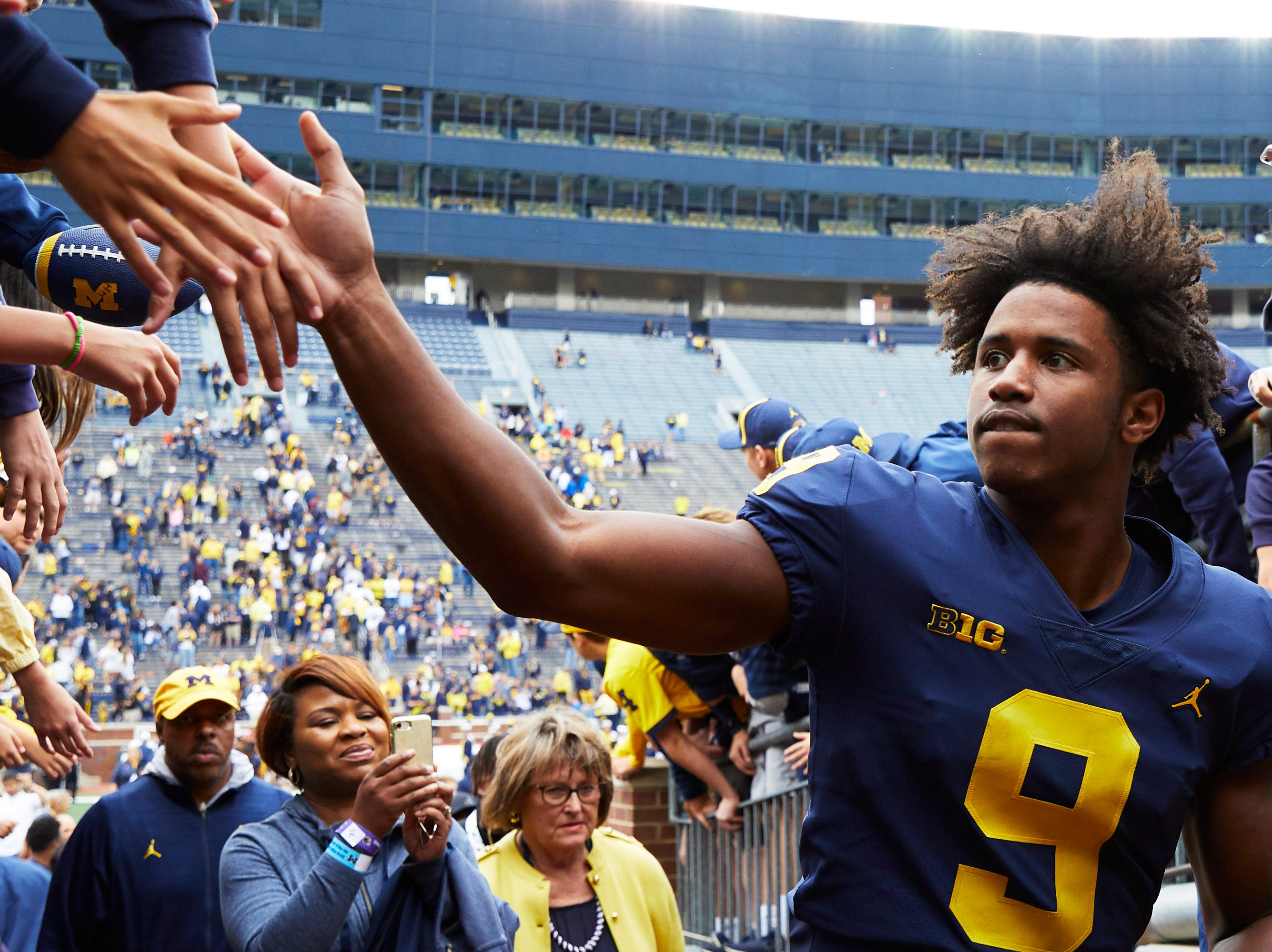 Sep 8, 2018; Ann Arbor, MI, USA; Michigan Wolverines wide receiver Donovan Peoples-Jones (9) high fives fans as he leaves the field after a game against the Western Michigan Broncos at Michigan Stadium. Mandatory Credit: Rick Osentoski-USA TODAY Sports
