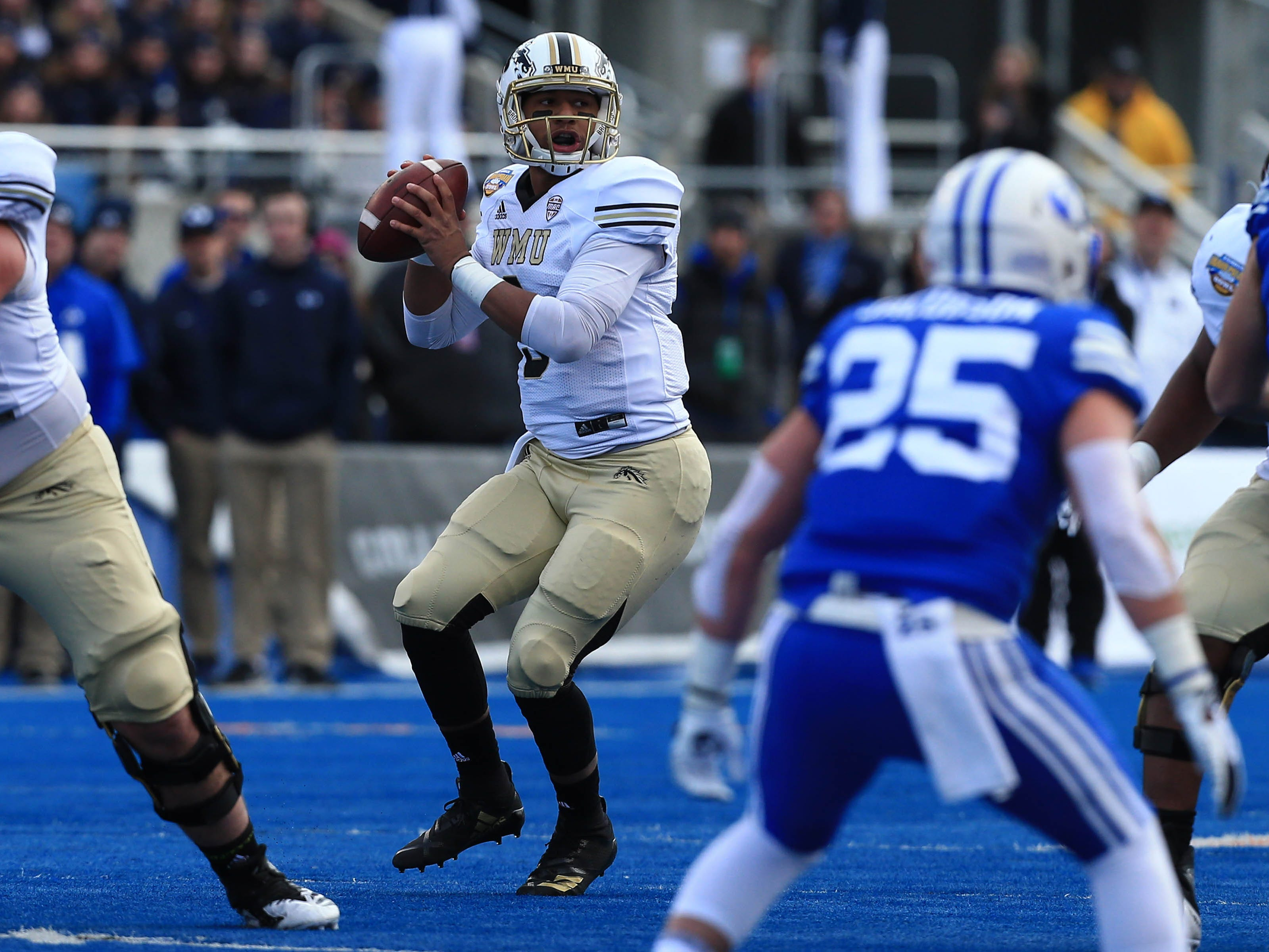 Dec 21, 2018; Boise, ID, United States; Western Michigan Broncos quarterback Kaleb Eleby (9) looks for a receiver during the first half against the Brigham Young Cougars during the  2018 Potato Bowl at Albertsons Stadium.