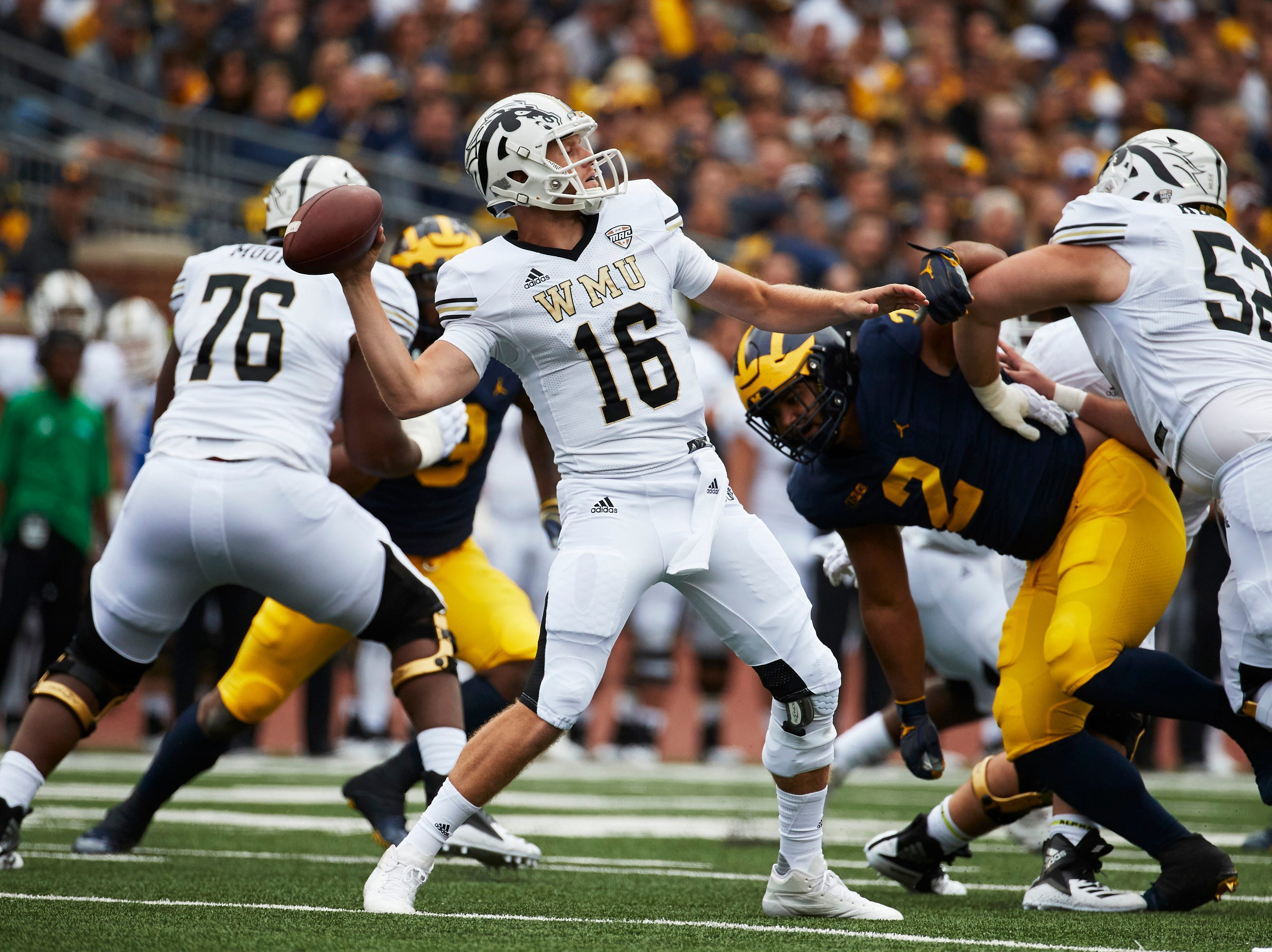 Sep 8, 2018; Ann Arbor, MI, USA; Western Michigan Broncos quarterback Jon Wassink (16) throws a pass in the first half against the Michigan Wolverines at Michigan Stadium. Mandatory Credit: Rick Osentoski-USA TODAY Sports