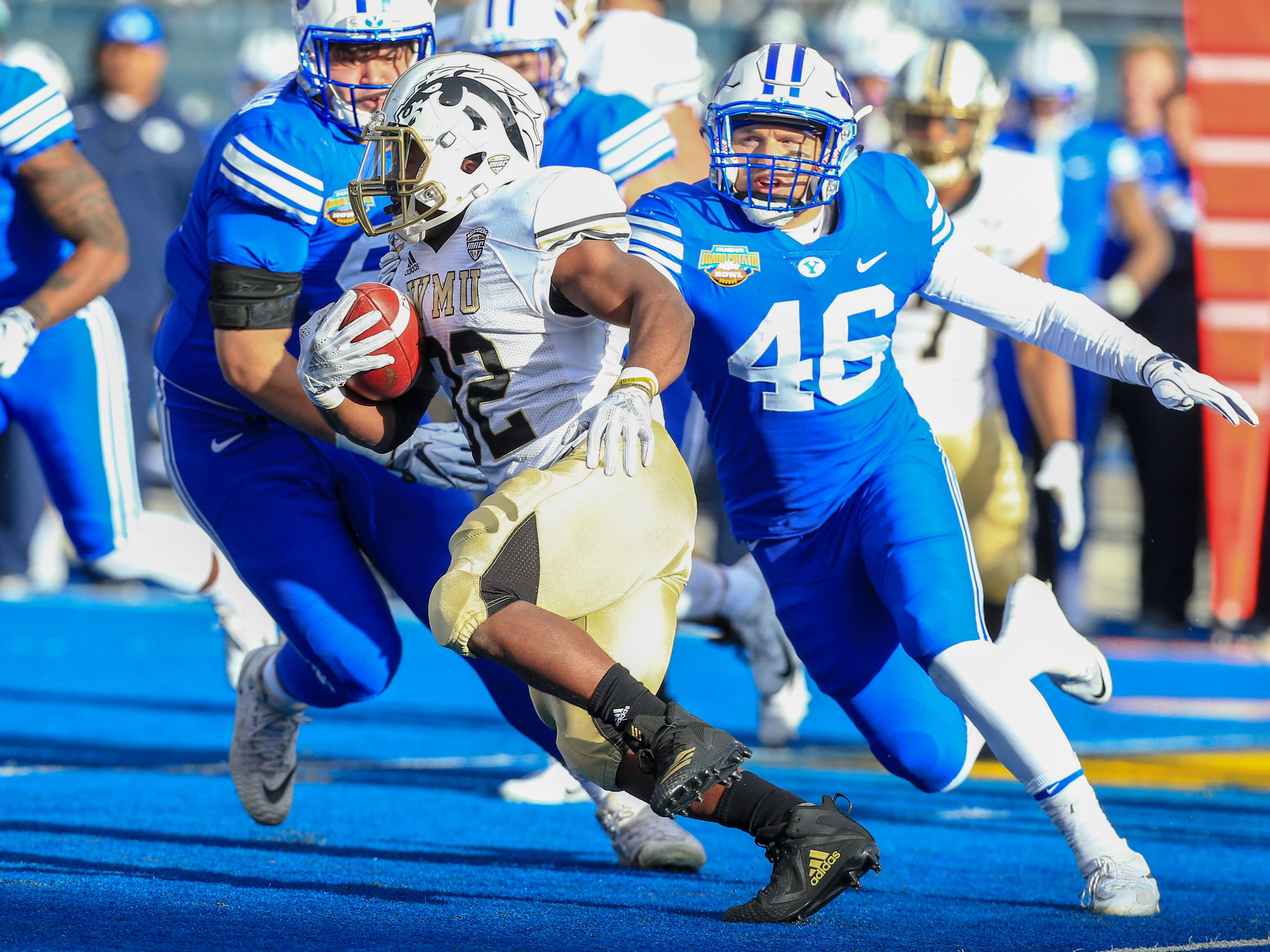 Dec 21, 2018; Boise, ID, United States; Brigham Young Cougars linebacker Rhett Sandlin (46) chases after Western Michigan Broncos running back Jamauri Bogan (32) during the first half  of play in the 2018 Potato Bowl at Albertsons Stadium.