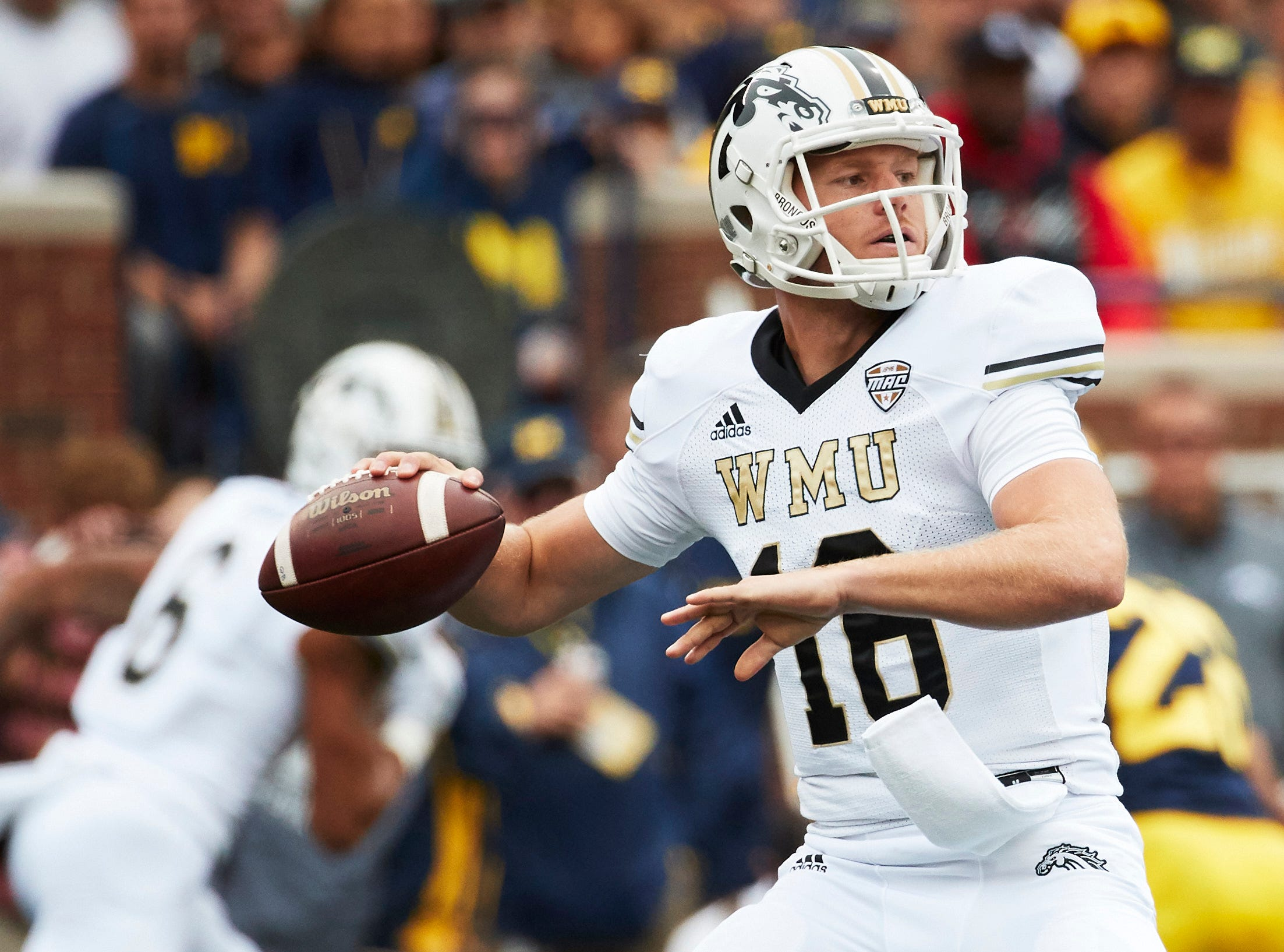 Sep 8, 2018; Ann Arbor, MI, USA; Western Michigan Broncos quarterback Jon Wassink (16) passes in the first half against the Michigan Wolverines at Michigan Stadium. Mandatory Credit: Rick Osentoski-USA TODAY Sports