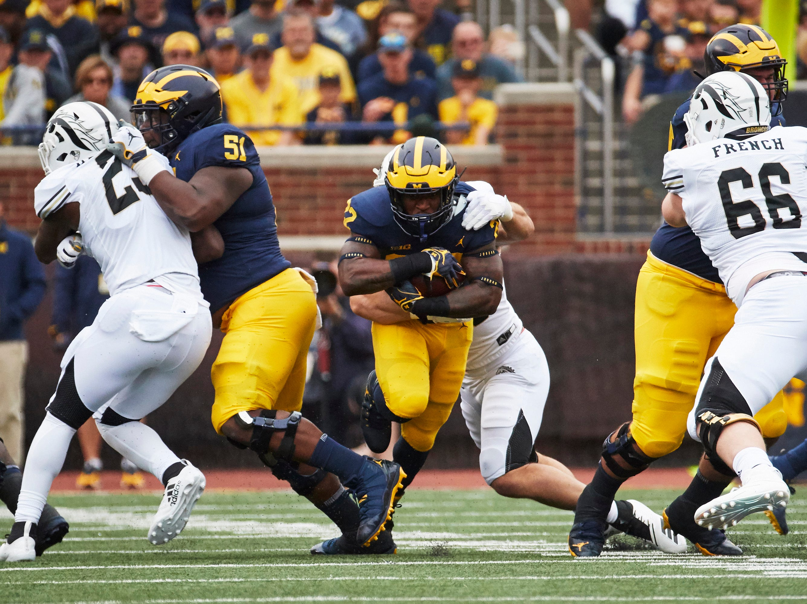 Sep 8, 2018; Ann Arbor, MI, USA; Michigan Wolverines running back Karan Higdon (22) breaks a tackle in the first half against the Western Michigan Broncos at Michigan Stadium. Mandatory Credit: Rick Osentoski-USA TODAY Sports