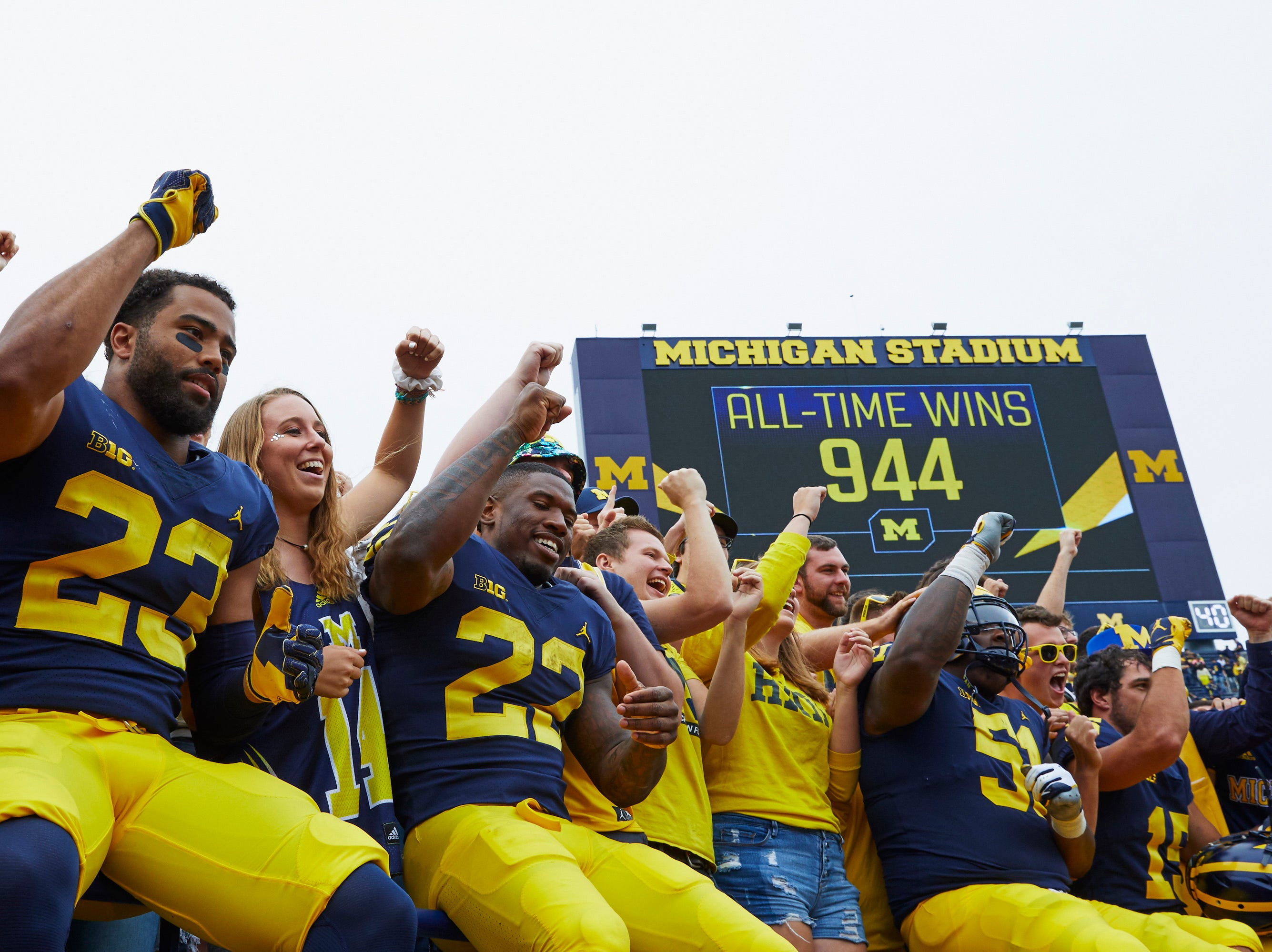 Sep 8, 2018; Ann Arbor, MI, USA; Michigan Wolverines defensive back Tyree Kinnel (23) and  running back Karan Higdon (22) celebrate in the student section after a game against the Western Michigan Broncos at Michigan Stadium. Mandatory Credit: Rick Osentoski-USA TODAY Sports