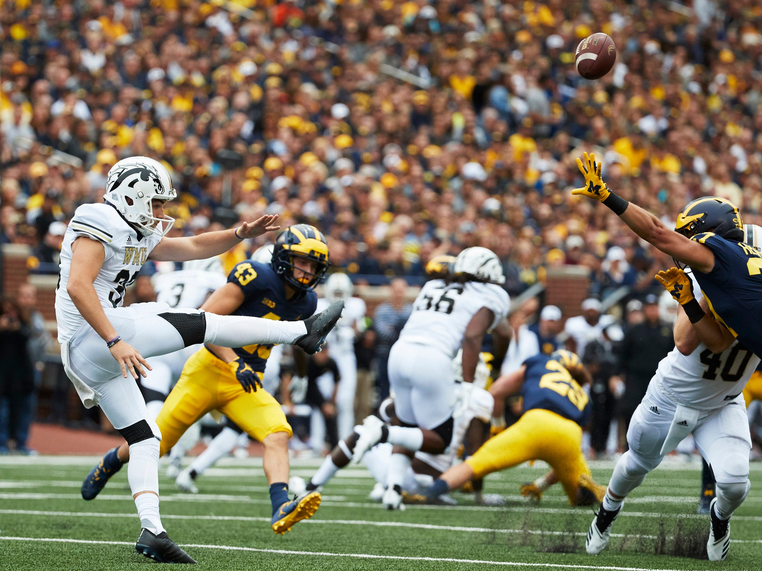 Sep 8, 2018; Ann Arbor, MI, USA; Western Michigan Broncos punter Nick Mihalic (39) punts over Michigan Wolverines running back Joe Hewlett (27) in the first half at Michigan Stadium. Mandatory Credit: Rick Osentoski-USA TODAY Sports