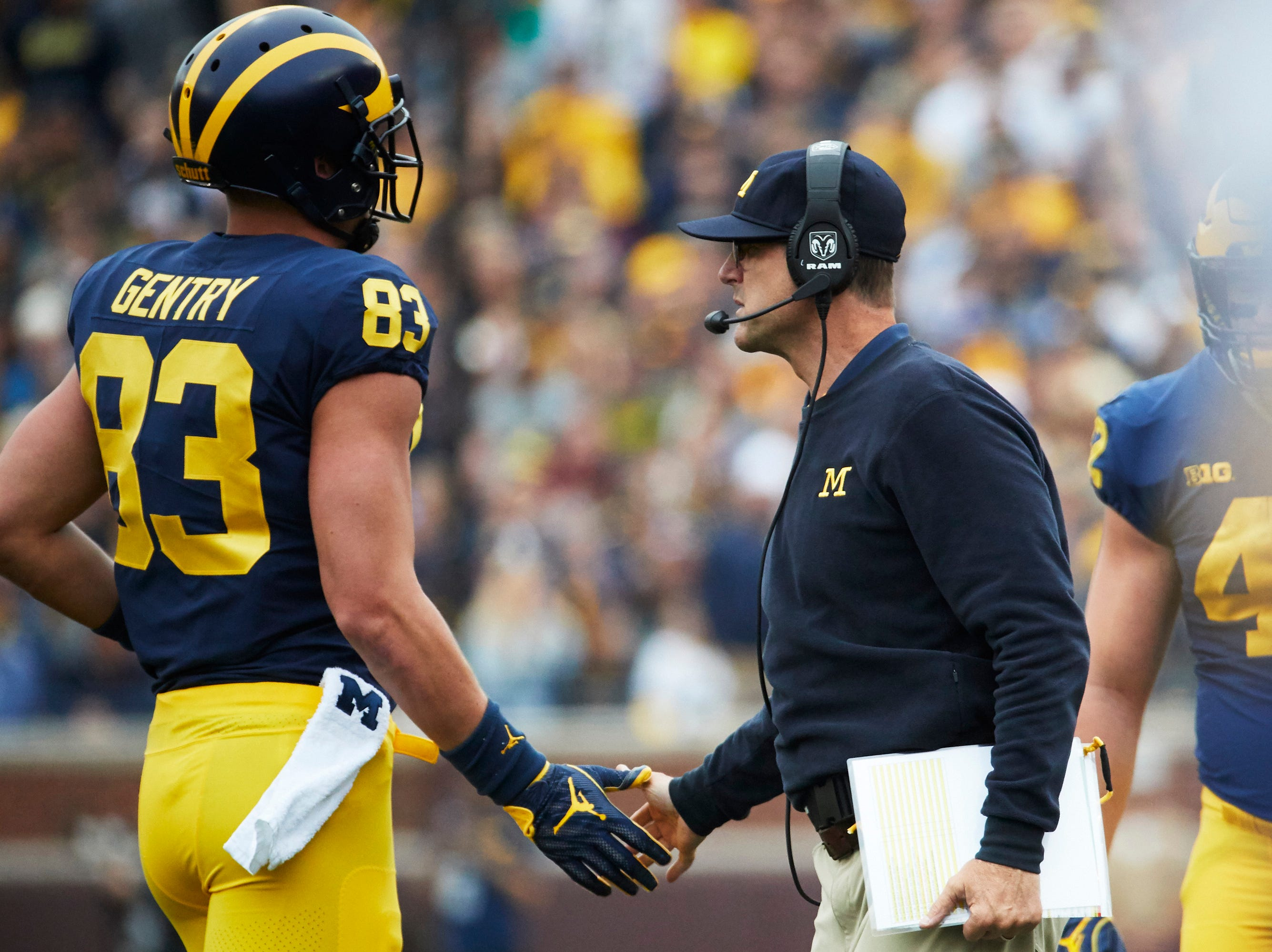 Sep 8, 2018; Ann Arbor, MI, USA; Michigan Wolverines head coach Jim Harbaugh greets tight end Zach Gentry (83) after a extra point in the first half against the Western Michigan Broncos at Michigan Stadium. Mandatory Credit: Rick Osentoski-USA TODAY Sports