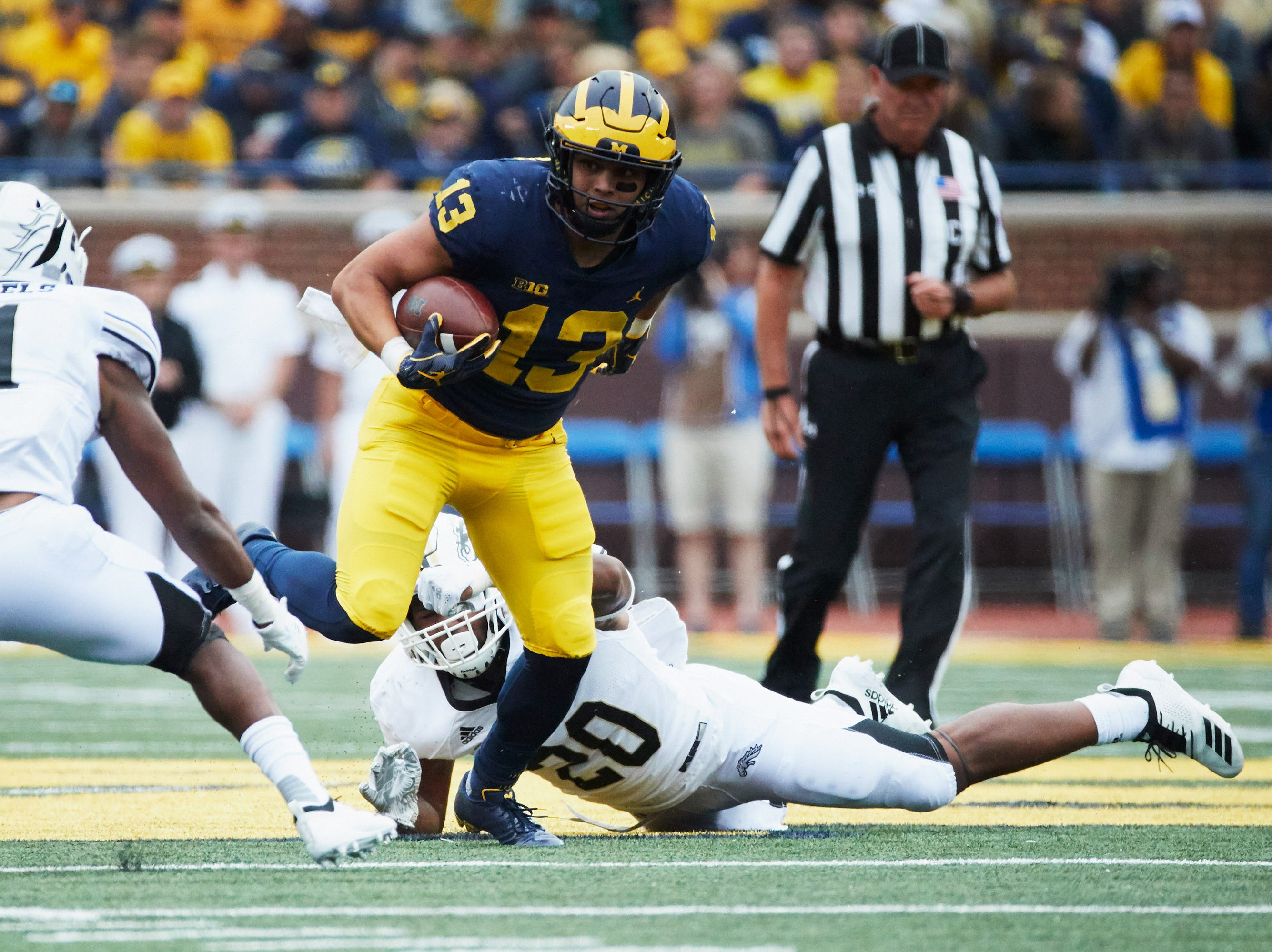 Sep 8, 2018; Ann Arbor, MI, USA; Michigan Wolverines running back Tru Wilson (13) rushes in the second half against the Western Michigan Broncos at Michigan Stadium. Mandatory Credit: Rick Osentoski-USA TODAY Sports