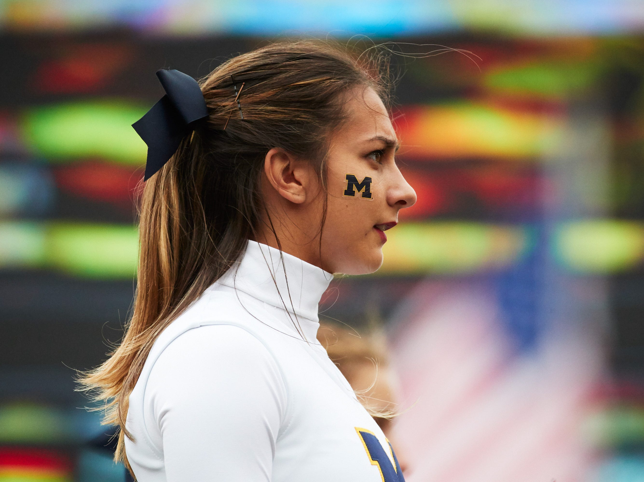 Sep 8, 2018; Ann Arbor, MI, USA; Michigan Wolverines cheerleader on the sideline in the first half against the Western Michigan Broncos at Michigan Stadium. Mandatory Credit: Rick Osentoski-USA TODAY Sports
