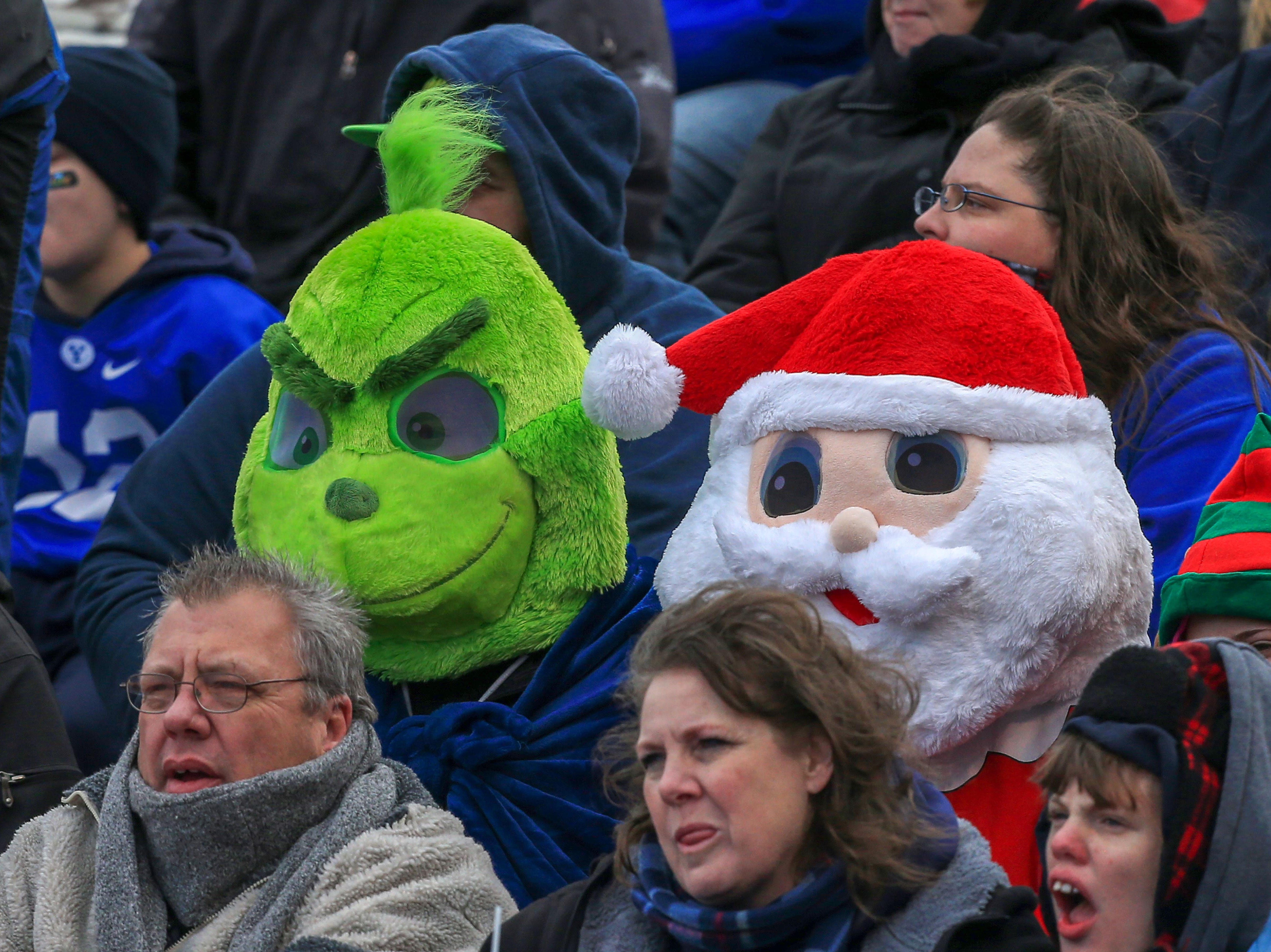 Dec 21, 2018; Boise, ID, United States; Fans dress up as the Grinch and Santa Claus during the first half  of play at the 2018 Potato Bowl between Western Michigan and BYU at Albertsons Stadium. Mandatory Credit: Brian Losness-USA TODAY Sports