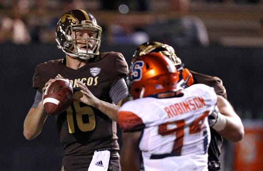 Aug 31, 2018; Kalamazoo, MI, USA; Western Michigan Broncos quarterback Jon Wassink (16) looks for an open man during the fourth quarter against the Syracuse Orange at Waldo Stadium.