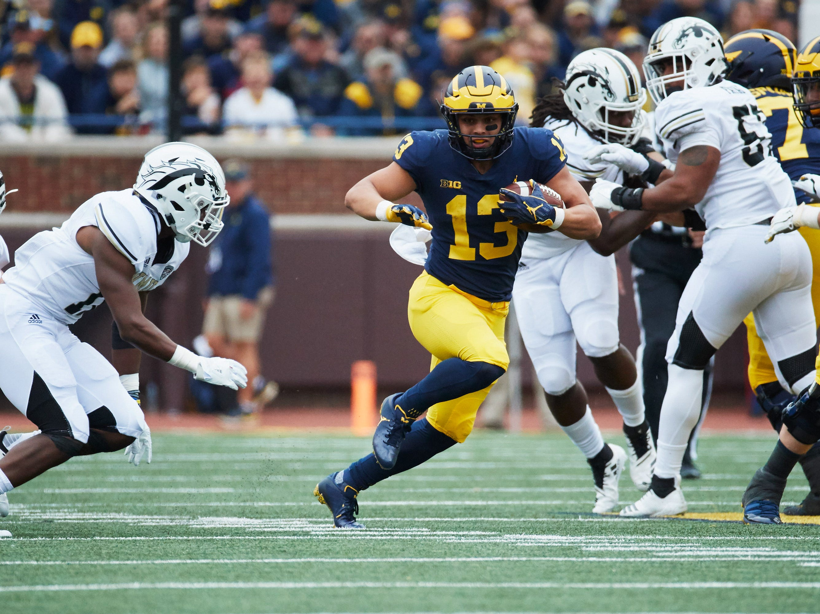 Sep 8, 2018; Ann Arbor, MI, USA; Michigan Wolverines running back Tru Wilson (13) runs the ball against the Western Michigan Broncos at Michigan Stadium. Mandatory Credit: Rick Osentoski-USA TODAY Sports