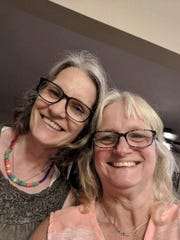 Lydia Brennan, left, and her half-sister, Debbie, who met for the first time in 2018.
