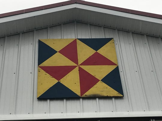 A painting, which now hangs on a new multi-purpose building, still has burn marks from when a fire ripped through Aukema Dairy Farm in October of 2017. The painting was saved in the fire.