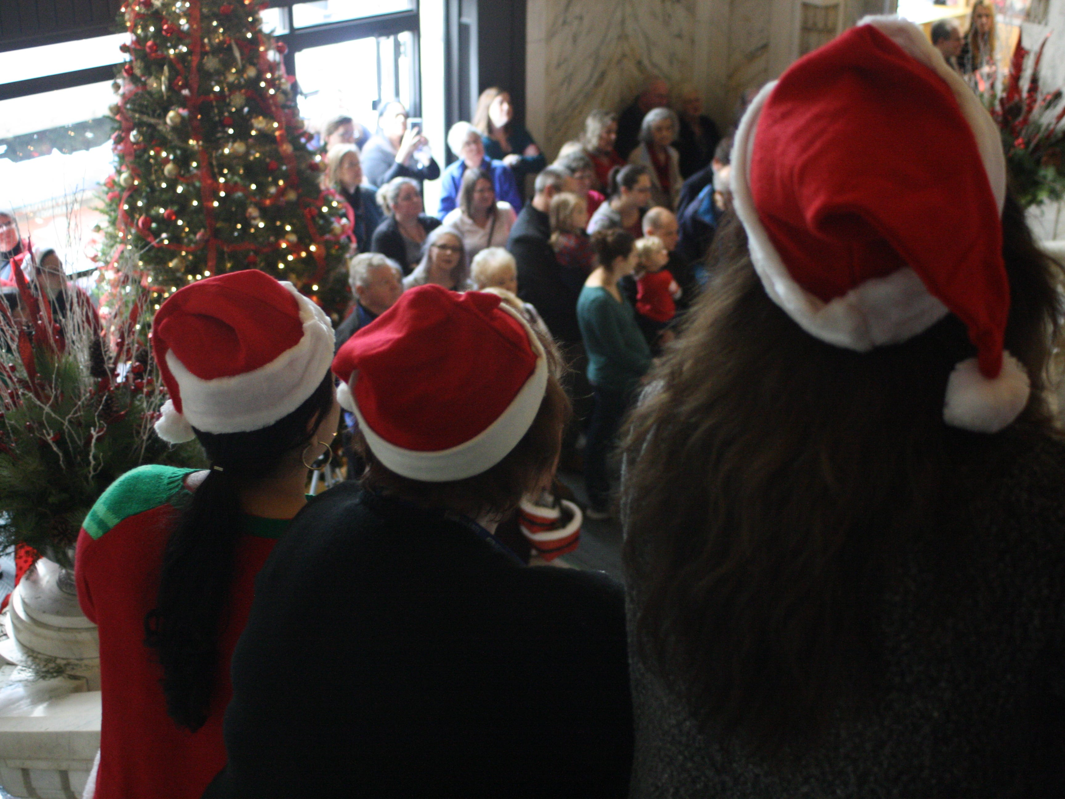 Security Mutual employees continued an annual tradition by singing Christmas carols in the company's lobby in Downtown Binghamton Friday afternoon.