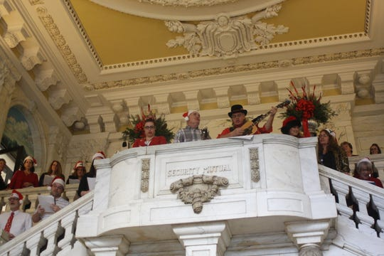 Employees of Security Mutual in Downtown Binghamton sang Christmas carols in the company's lobby Friday afternoon.