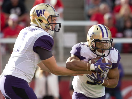 Jake Browning handing off to Myles Gaskin has been an effective combination for the Huskies for four years.
