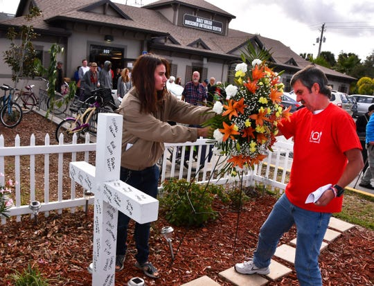Karen Brown and Chris Melton place a wreath in the memorial garden. A ceremony was held at The Daily Bread Friday afternoon for all the homeless who had died this year. Prayers were said, the names of all who had died read  and a wreath placed in their honor in a memorial garden.