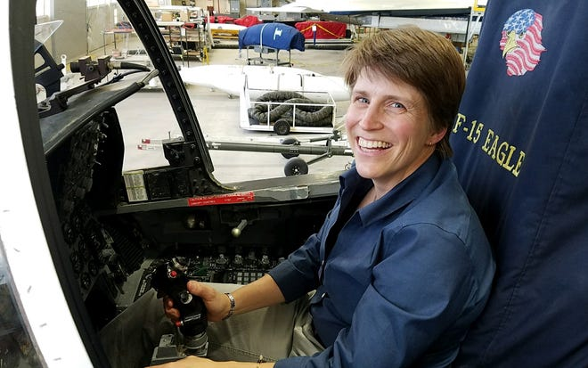 Jennifer Fowler sits in an F15 cockpit while touring NASA Armstrong Space Flight Center. Part of her position with NASA Space Grant is to advocate for Montana students to get research experience at NASA centers.