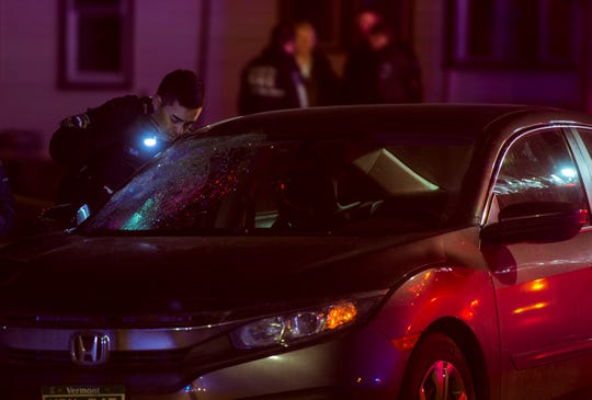 Police inspect the car that struck and killed Jonathan Jerome, 61, of Winooski as he was crossing North Avenue in Burlington on Thursday night, Dec. 20, 2018.