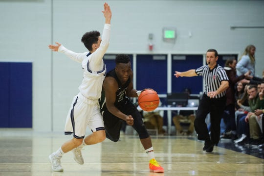 Rice's Michel Ndayishimiye (2) drives past Burlington's Jackson Sevakian (1) during the boys basketball game between the Rice Green knight and the Burlington Sea Horses at Burlington High School on Thursday night December 20, 2018 in Burlington.