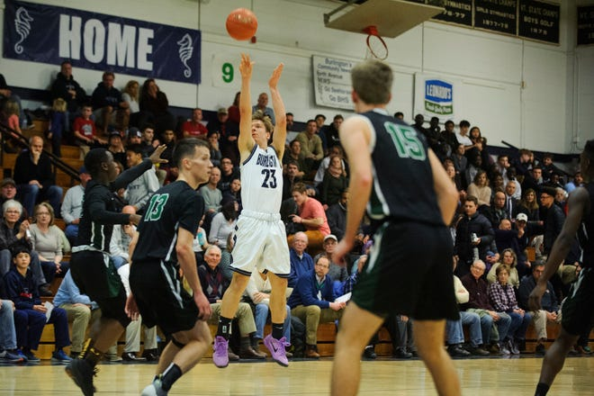 Burlington's Ryan Murray (23) shoots a three pointer during the boys basketball game between the Rice Green knight and the Burlington Sea Horses at Burlington High School on Thursday night December 20, 2018 in Burlington.