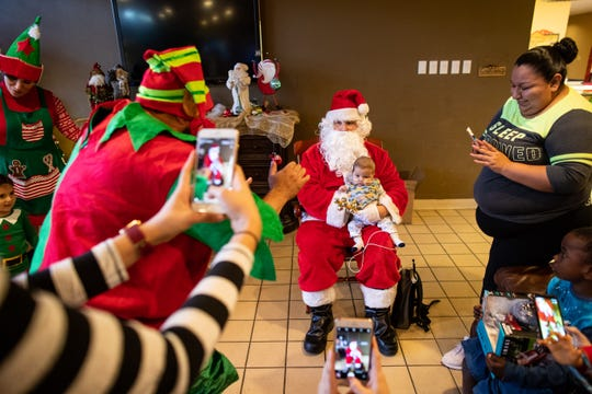Patient staying at the Ronald McDonald House of Corpus Christi has their photo taken with Santa on Friday, Dec. 21, 2018.