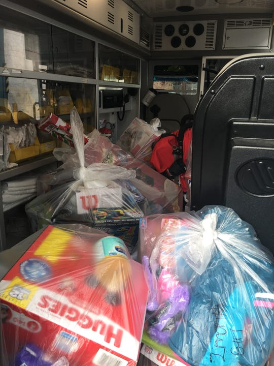 Truckloads of toys, clothes and other items were delivered Friday to families impacted by a fire in North Camden.