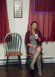 Meranda Puckett enjoys a coffee made by Vanessa Escamilla before the open house officially started at Bugg's House in Chillicothe, Ohio. Puckett has lived in the house for about a month and has been sober for almost five months.