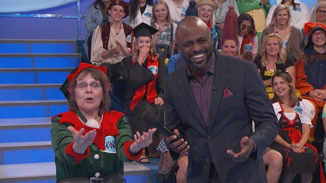 Bonnie Baldridge, of Greenfield, reacts along with Let's Make a Deal host Wayne Brady during a recent taping of the show.