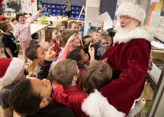 Santa Claus was greeted with huge fan fair as he visited each Chillicothe Primary School classroom Friday morning. The students wrote Santa Claus a letter telling them what they wanted for Christmas, which was given to Thomas Worthington High School teacher Judith Galasso.