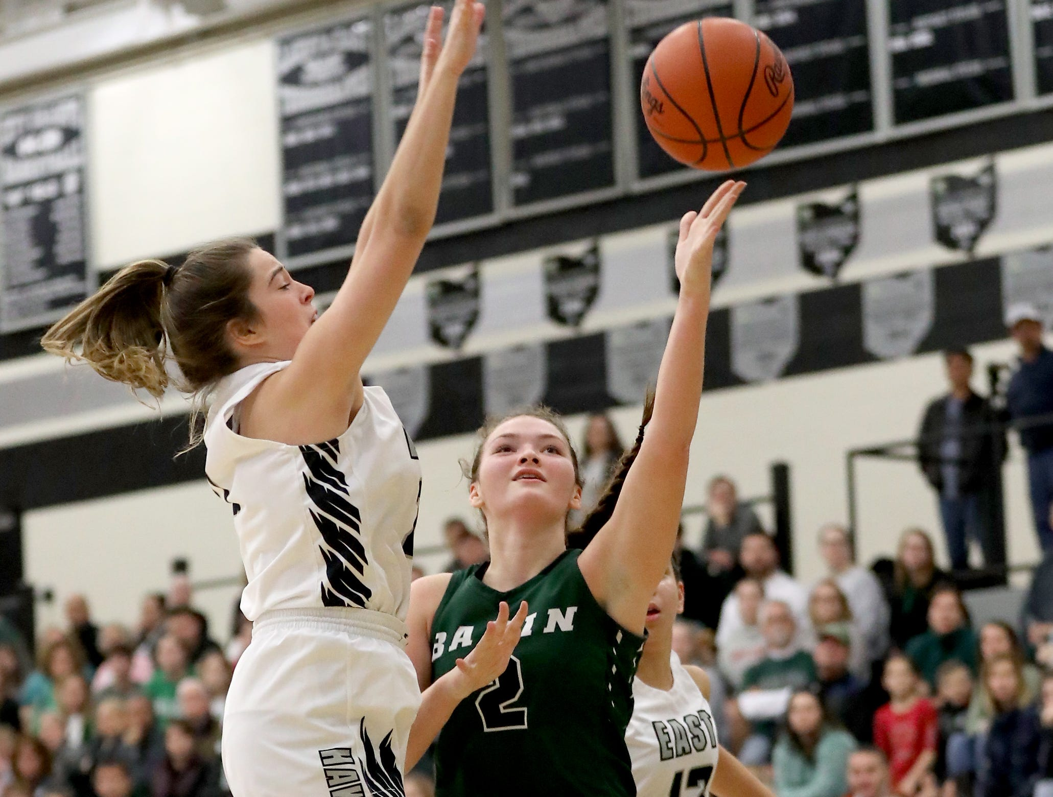 Badin guard Shelby Nusbaum (12) drives to the basket during the Rams' game against Lakota East, Thursday, Dec. 20, 2018.