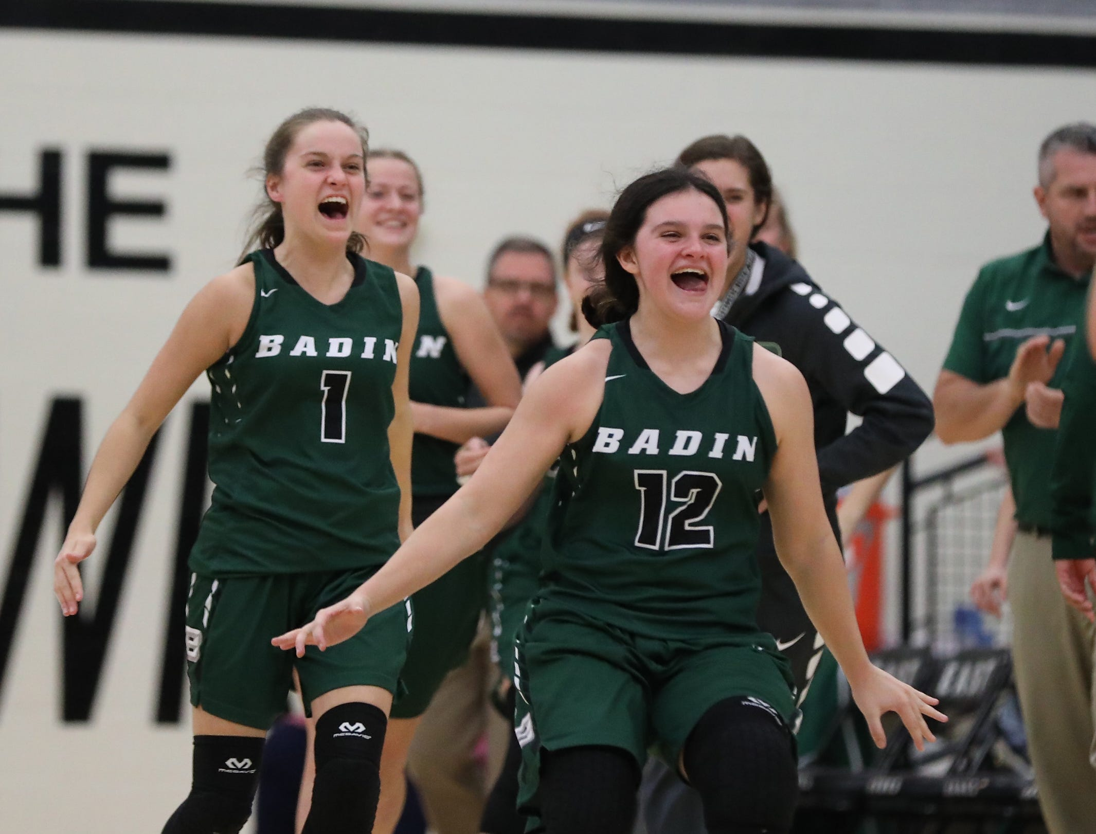 Badin players celebrate after forward Emma Broermann scored her 1,000th point during the Rams' game against Lakota East, Thursday, Dec.20,2018.
