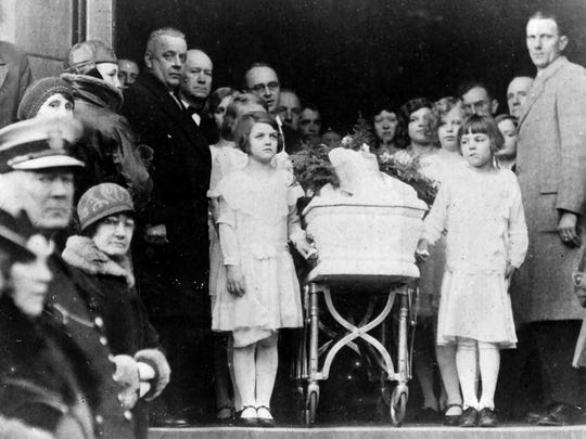 Marian McLean's friends carry her casket out of the now demolished St. Patrick's Church in Covington two days after Christmas in 1931.