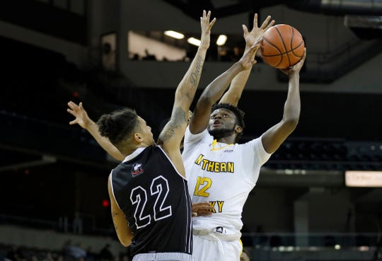 Northern Kentucky Norse guard Trevon Faulkner (12) drives against Northern Illinois Huskies guard Rod Henry-Hayes (22).