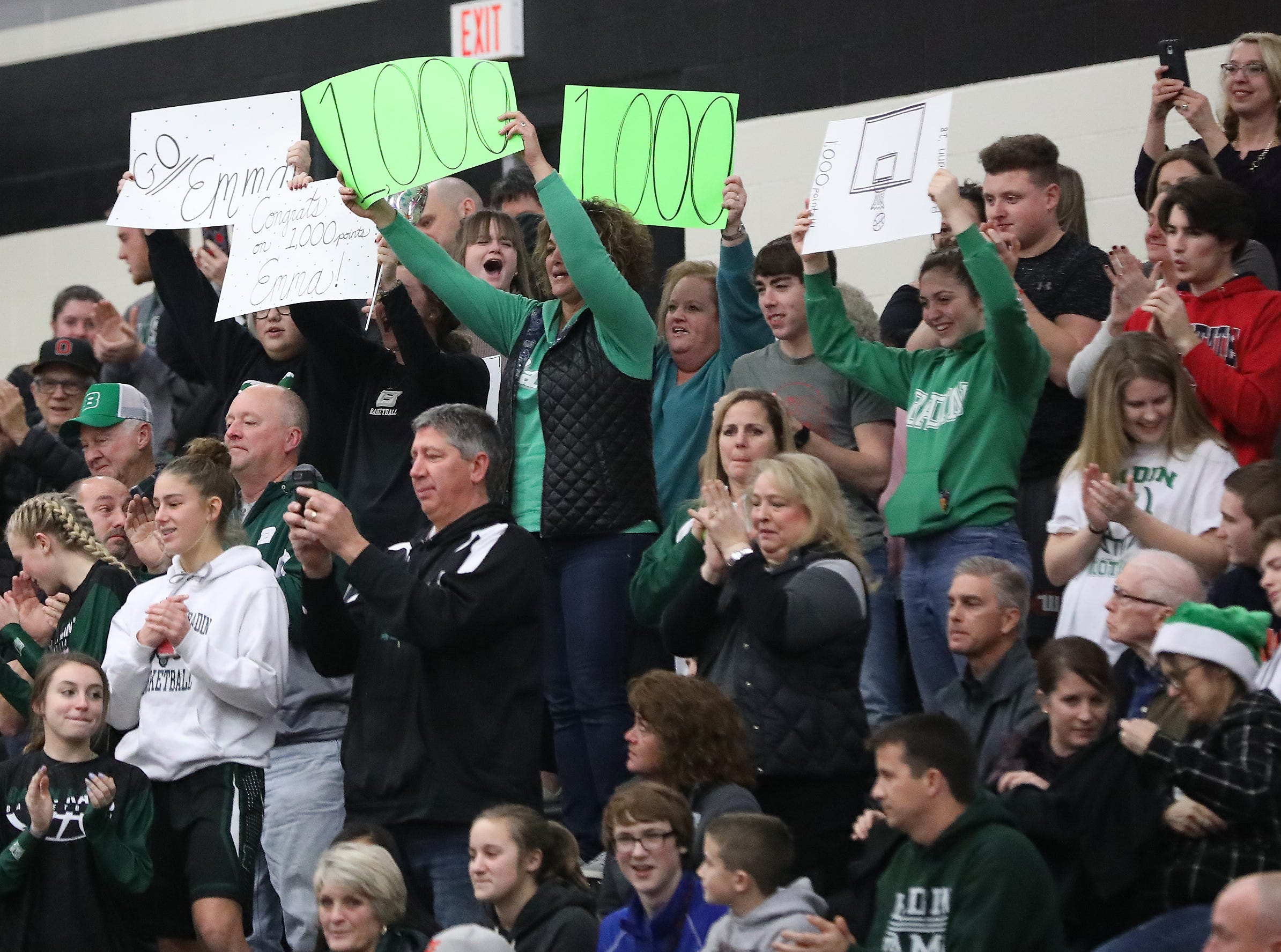 Badin fans cheer on  forward Emma Broermann after she scored her 1,000th point during the Rams' game against Lakota East, Thursday, Dec. 20, 2018.