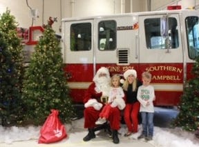 Amy Bell with children Austin and Aubrey at the first-ever Breakfast with Santa and His Firemen on Dec. 1.