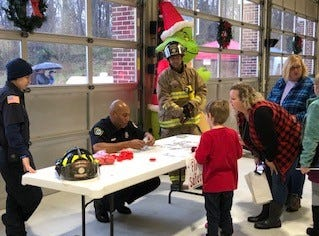 Families mingle with firefighters and paramedics at the first-ever Southern Campbell Fire Department Breakfast with Santa and His Firemen on Dec. 1, 2018