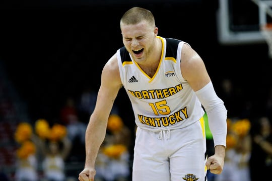 Northern Kentucky Norse guard Tyler Sharpe (15) cheers after a shot in the second half of the NCAA basketball game between the Northern Kentucky Norse and the Northern Illinois Huskies at BB&T Arena in Highland Heights, Ky., on Thursday, Dec. 20, 2018. The Norse completed a second half comeback to win 65-62.