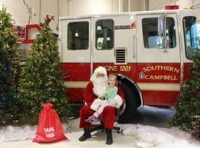 Annabelle Brown meets Santa at the first-ever Breakfast with Santa and His Firemen on Dec. 1.