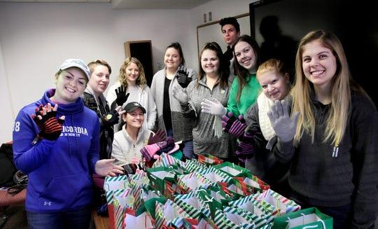 Left to right: Katelyn Campbell, Rachel Ahern, seated Molly Hasay, Sarah Kwiatkowski, Mary O'Leary, Alysa Leggieri, Tyler Soos, Erin Flanagan, Kendra Mattice, Lindsay Lord.