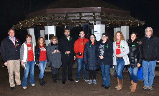 Union County Freeholder Chairman Sergio Granados and Freeholder Bruce H. Bergen joined members of the New Jersey chapter of Moms Demand Action for Gun Sense in America for a candle light vigil in Echo Lake Park in Mountainside to honor the memory of the 26 children and adults who were murdered in a single act of gun violence at the Sandy Hook Elementary School in Connecticut in 2012.