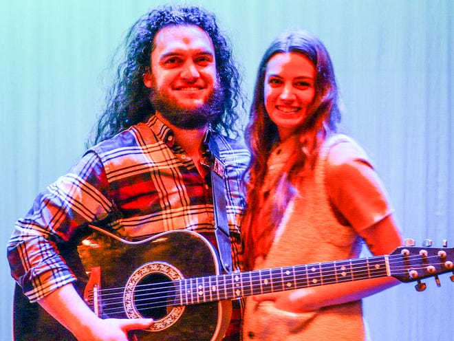 Del Val music teacher T.J. Hayden and fiancée Isabel Williams pose for a picture in the stage lights minutes after he publicly popped the question providing a grand finale to the Delaware Valley High School staff talent show.