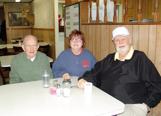 Peggy Sue Wilson, center, with longtime customers Eddie Bowman and Greg Finan.